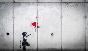 girl losing heart balloon